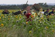 На месте крушения Боинга в Украине обнаружили ранее ненайденные останки пассажиров